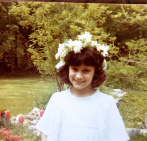 """Beth as a child with her """"hand made"""" flower wreath."""