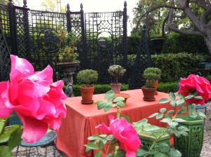 The rose garden blooms all summer in shades of red and pink.