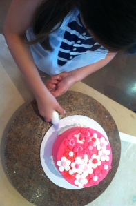 "Children have ""hands on"" experience for decorating cakes."